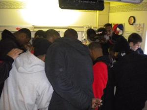 The University of Cincinnati basketball team praying over my hospital bed
